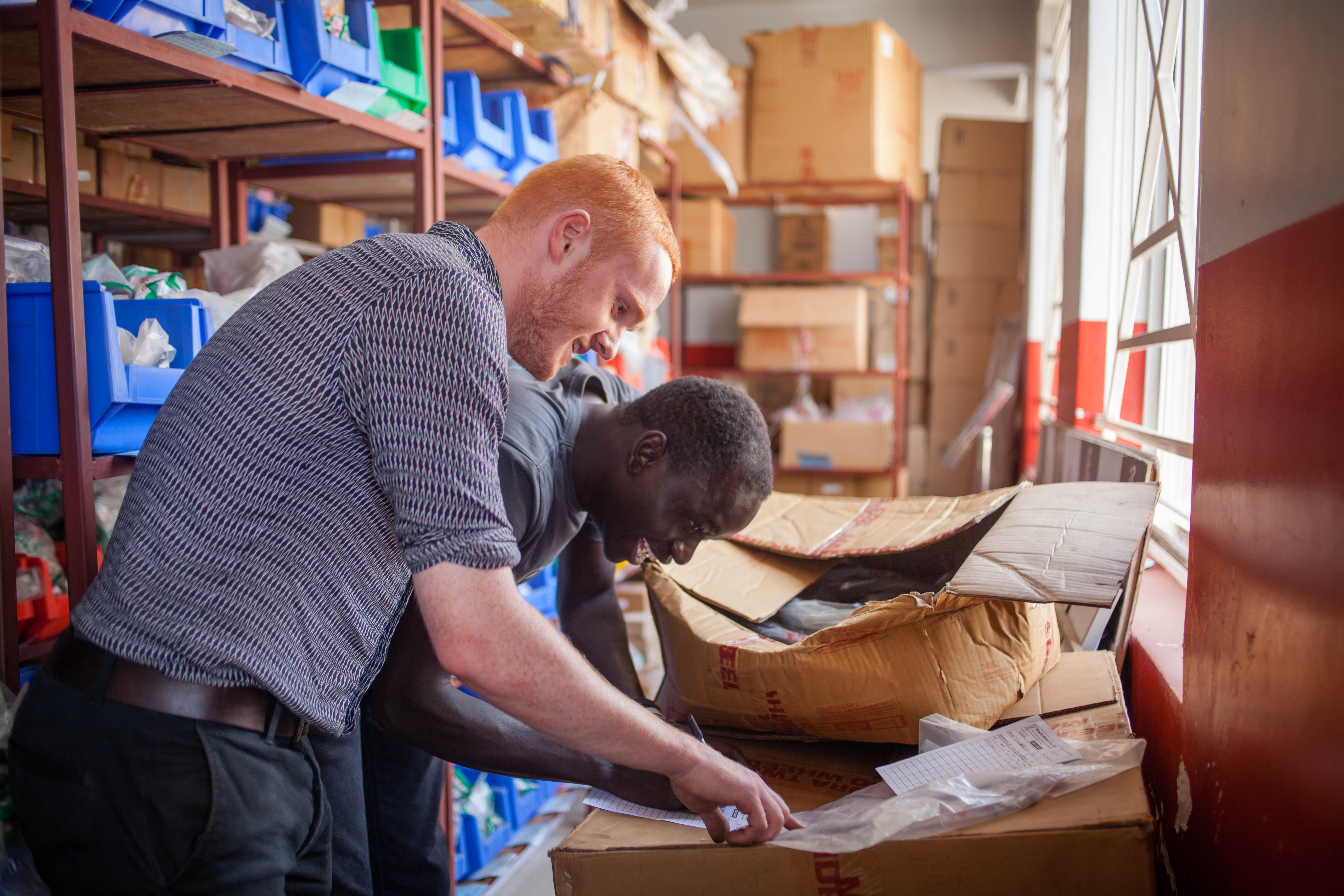 Challenges Worldwide Business Support Associates Richard and Omara Work at Miracle Motor Kampala Uganda Esther Mbabazi
