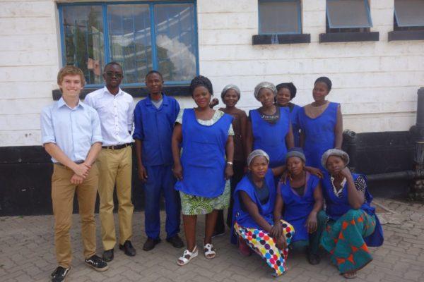 Jesse Cross and Kondwani Ngoma with AWC Fine Foods Limited team, Lusaka, Zambia