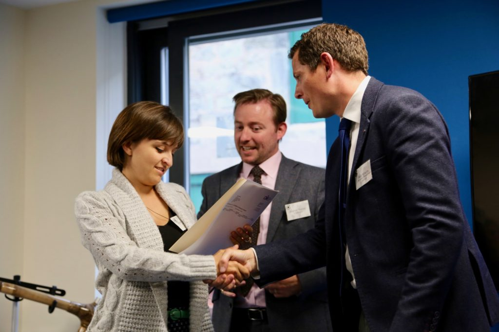Rosie being awarded her CMI certification by Matt Roberts from the CMI