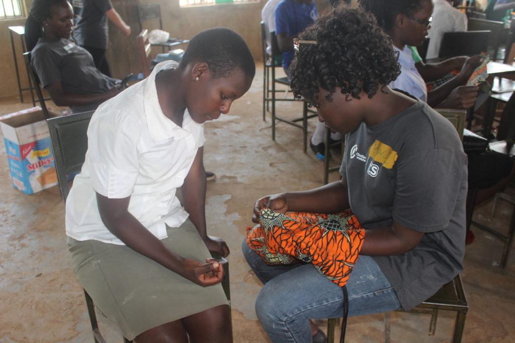 Health Impact Day Uganda: Girls makeng their sanitary pads